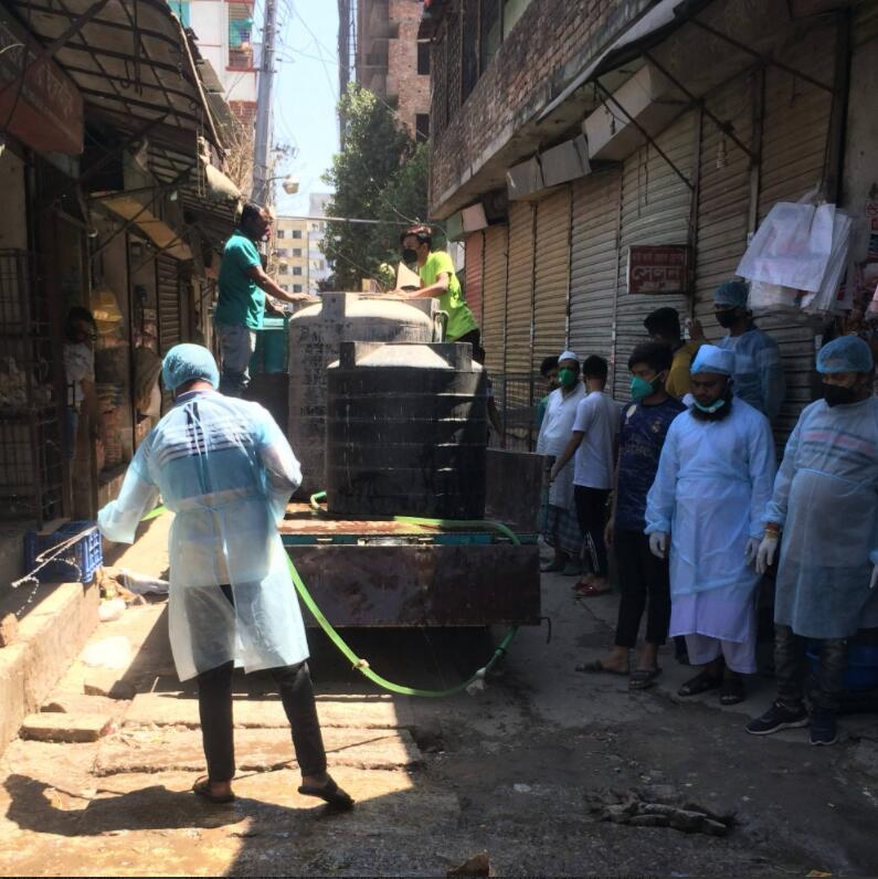 As a measure against SARS-CoV-2, bleach is diluted in some areas and sprayed with water - here in Dhaka