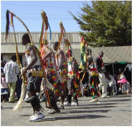 Bassari - colorful costumes and modern footwear