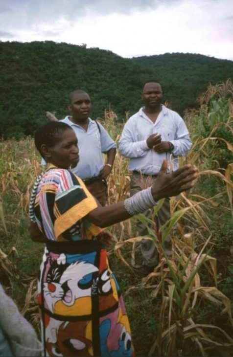 Farmer's wife with agricultural advisors