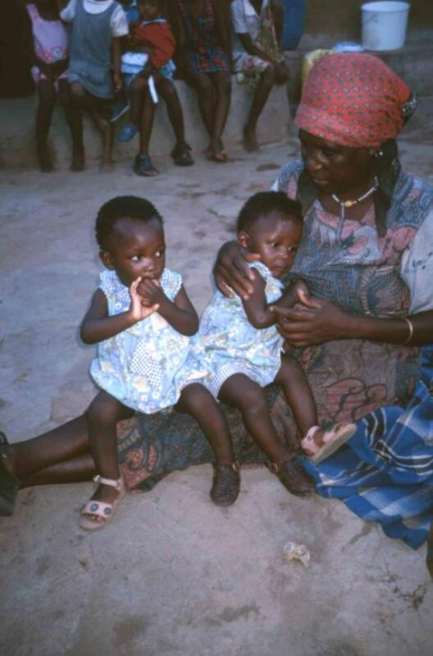 Old woman with small children