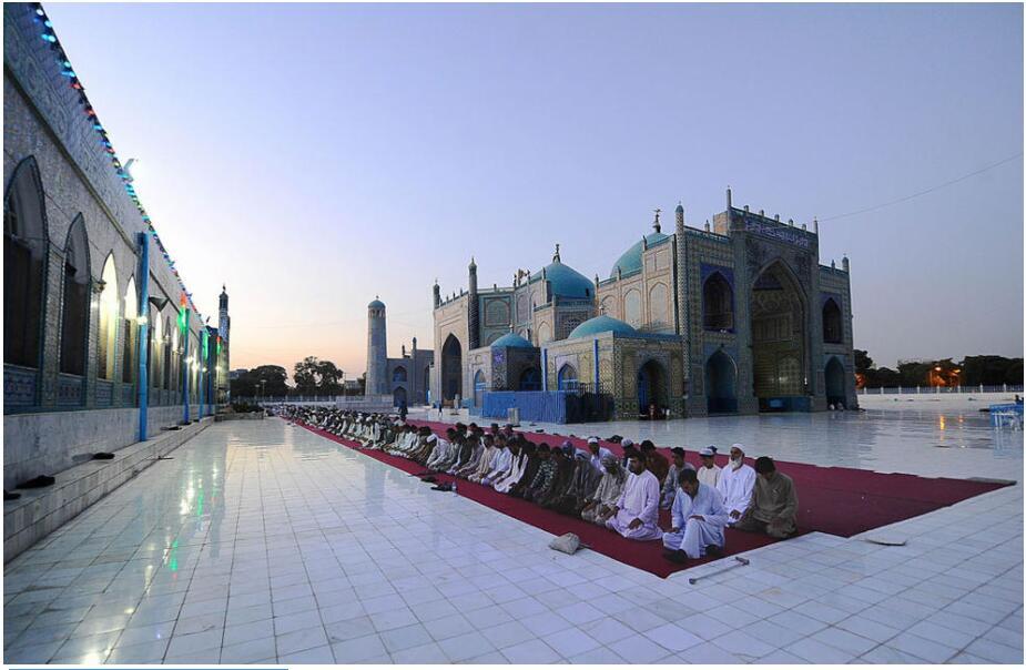 Prayer at the Blue Mosque in Mazar-e Sharif, Afghanistan