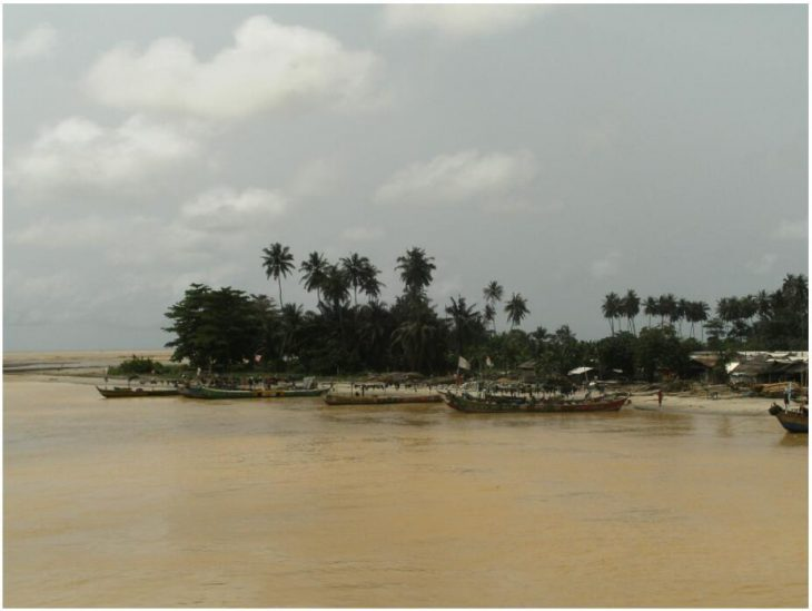 The mouth of the mud-contaminated river Ankobra